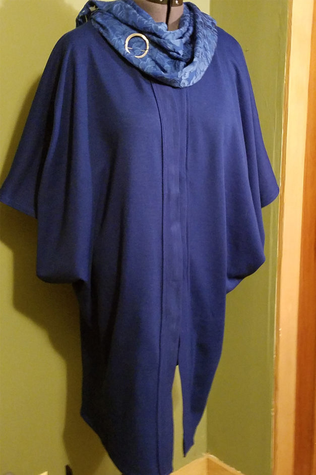 """All wool kimono-style cape clasps with """"frog"""" clasps."""